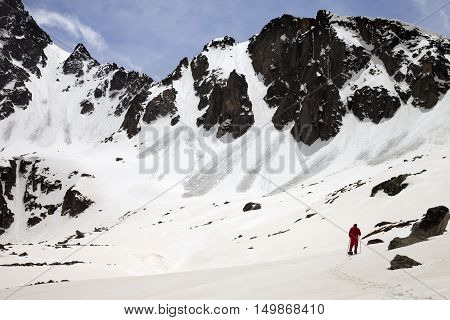 Hiker in snow mountain with trace from avalanches at sun spring day. Turkey Kachkar Mountains highest part of Pontic Mountains.