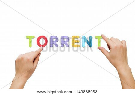 Hand put the word Torrent with magnetic letters. Colorful alphabet kit