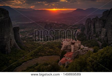 Evening view on the Meteora vally with the Rousanou the St. Nicholas Anapausas and Grand Meteora monasteries