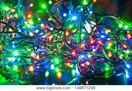 Electric garland. Abstract Christmas background green red yellow and blue colors