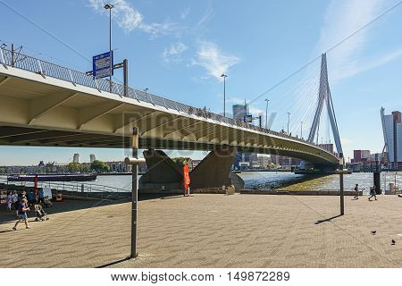 Rotterdam, Netherlands - May 26: Rotterdam, Netherlands - May 26, 2016: Picture of the Erasmus bridge with on the right de building Tower on South, taken August 18, 2016 in Rotterdam, Netherlands.