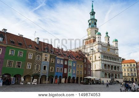Poznan Poland - September 29 2016: People visiting Poznan Old Town with beautifully decorated the city hall and colorful townhouses so called