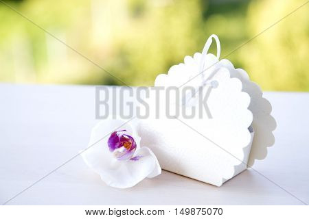 Wedding cake box with white orchid bokeh
