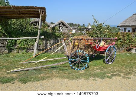 The Cart Without A Horse With Hay And Pumpkins