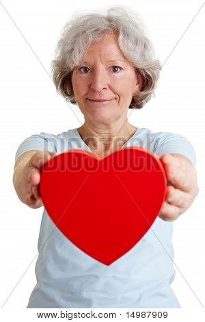 Retired Woman Donating Red Heart