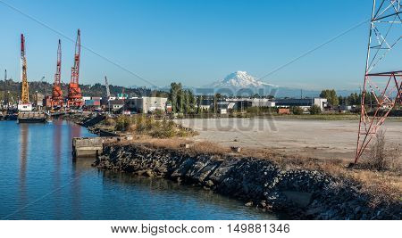 Mount Rainier can be seen in the distance at an industrial area near the Port of Tacoma.