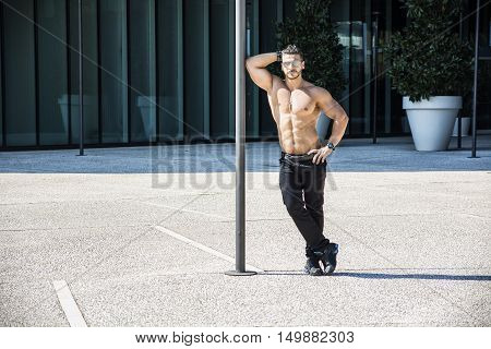 Handsome Muscular Shirtless Hunk Man Outdoor in City Setting. Showing Healthy Body While Looking At Camera