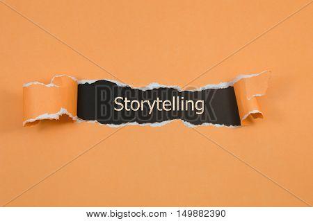 Storytelling written under torn paper. business concept