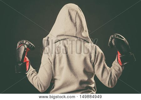 Boxer In Hoodie Stand Backwards With Arms In Air.