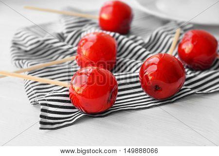 Toffee apples on stripe napkin