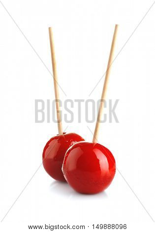 Toffee apples on white background