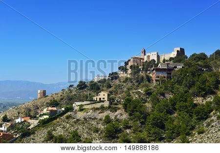 a view of the Sanctuary of the Virgen del Castillo, built between 1891 and 1897, in the top of a hill, in Cullera, Spain