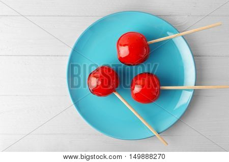 Toffee apples on blue plate