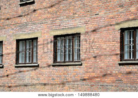 OSWIECIM POLAND - MAY 12 2016: Wall with windows block in concentration camp Auschwitz-Birkenau in Oswiecim Poland.
