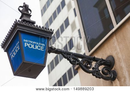 Traditional British Metropolitan Police lamp sign outside police station, London, England