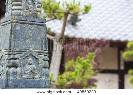 Carving of Buddha on a statue at an Asian Buddhist Temple