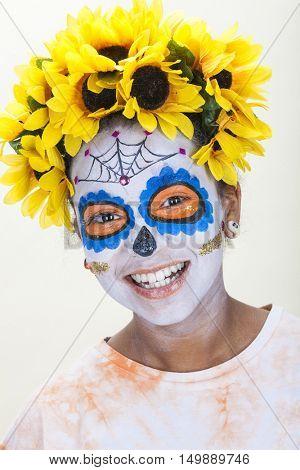 Happy girl in Dia de los Muertos, Day of The Dead, Halloween make up