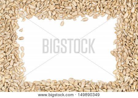 Natural shelled sunflower seeds frame over white background