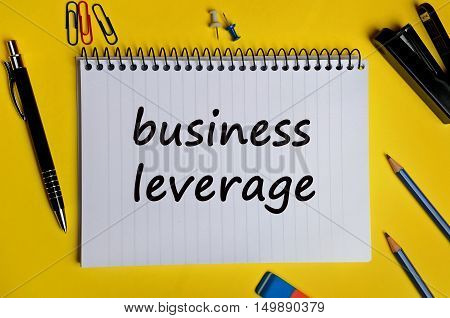 Business leverage words written on notebook closeup