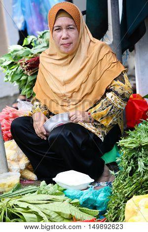 BANDAR SERI BEGAWAN, BRUNEI May 23 2014 - Unidentified woman at riverside market