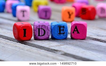 Idea word on gray wooden table closeup
