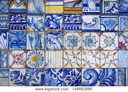 Background of old and damaged typical Portuguese tiles from the XVII Century