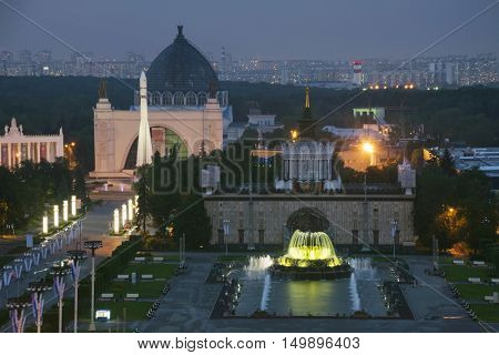 Beautiful Fountain with illumination, pavilions, rocket in VDNKh at night in Moscow, Russia
