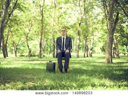 Green Businessman Environmental Conservation Businessman Sitting Concept