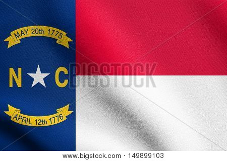 North Carolinian official flag symbol. American patriotic element. USA banner. United States of America background. Flag of the US state of North Carolina waving in wind with detailed fabric texture, illustration