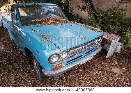 Blue Datsun 1300 Pickup Car