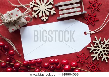 Christmas Decoration Like Gift Or Present, Sleigh. Card For Seasons Greetings With Red Paper Background. Copy Space For Advertisement Or Free Text