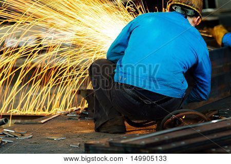Workers at the construction site using a metal cutting torch