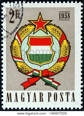 HUNGARY - CIRCA 1958: A stamp printed in Hungary issued for the 1st anniversary of Amended Constitution shows Arms of Hungary, circa 1958.