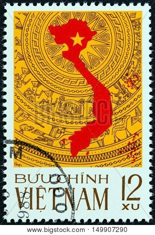 VIETNAM - CIRCA 1976: A stamp printed in North Vietnam issued for the Reunification of Vietnam shows map on the bronze drum pattern, a symbol of the culture of Vietnam, circa 1976.