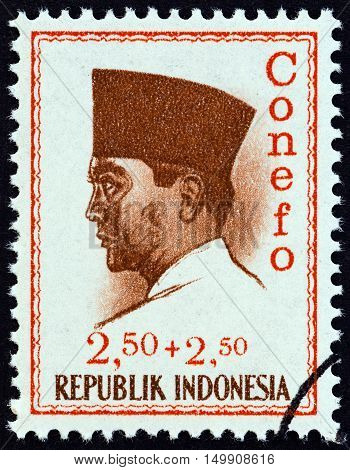 INDONESIA - CIRCA 1965: A stamp printed in Indonesia shows president Sukarno commemorating the 1965 Conference of New Emerging Forces, Djakarta Conefo, circa 1965.