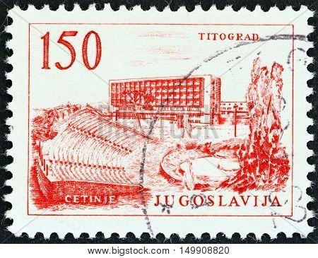 YUGOSLAVIA - CIRCA 1961: A stamp printed in Yugoslavia shows Titograd Hotel, circa 1961.
