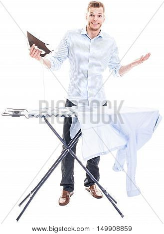Young Man Completely Overwhelmed With His Laundry And The Electric Iron - Isolated On White Backgrou