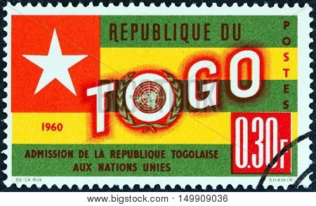 TOGO - CIRCA 1961: A stamp printed in Togo issued for the Admission of Togo into U.N shows Togo Flag, circa 1961.