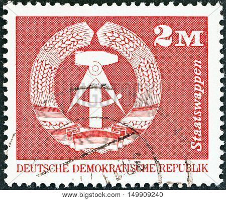 GERMAN DEMOCRATIC REPUBLIC - CIRCA 1973: A stamp printed in Germany shows Coat of Arms, circa 1973.