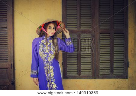 Portrait Asian girls with Ao-Dai Vietnam dress Ao dai is famous traditional costume for woman in VIetnam.