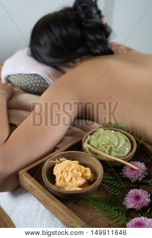 Massage series : Asian woman lying bareback on massage bed in spa