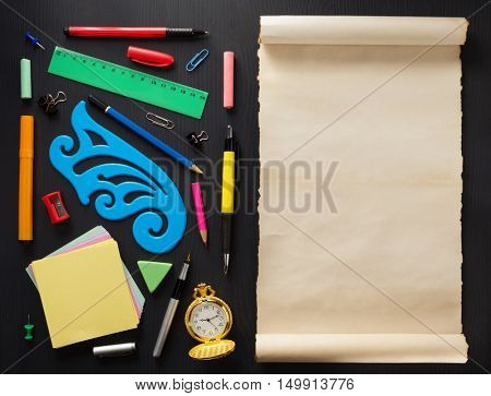 school supplies on black wooden background