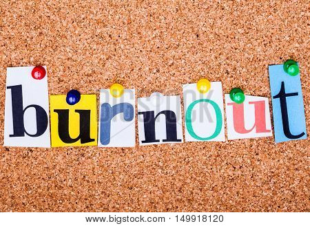 The Word Burnout In Cut Out Magazine Letters Pinned To A Cork Notice Board With Push Pins..
