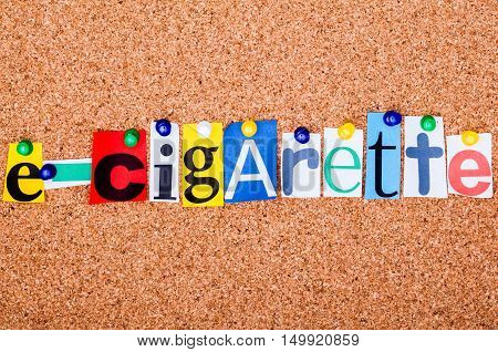 The Word E-cigarette In Cut Out Magazine Letters Pinned To A Cork Notice Board..