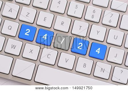 24/24 in blue on a white keyboard