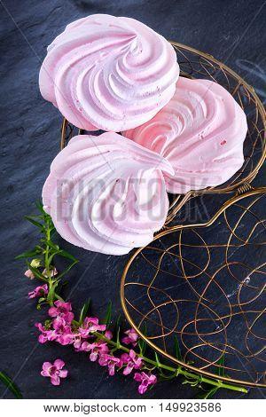 Pink Zephyr or marshmallow in light metal basket