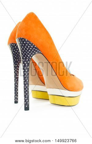Pare of orange and yellow high hill shoes isolated on white background