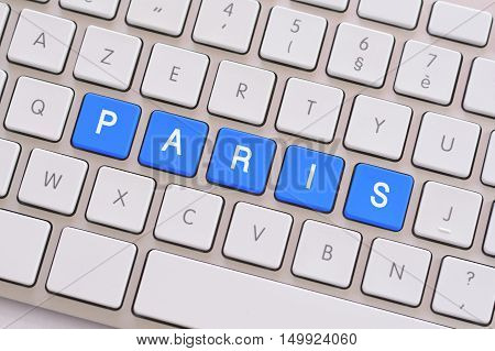 Paris in blue on a white keyboard