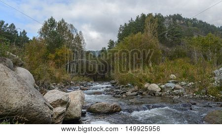 Stream in the mountains Sayan a tributary of the Yenisei River. Khakassia. Siberia.