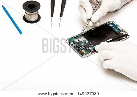 Technician Repairing Broken Mobile Phone
